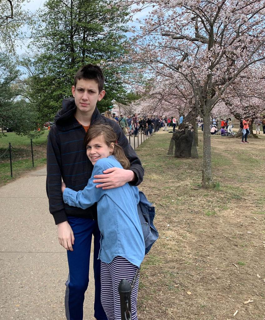 Sam and Sasha hugging